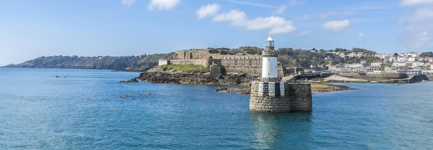 Entrance of Saint Peter Port on Guernsey Island with the Castle Cornet in background