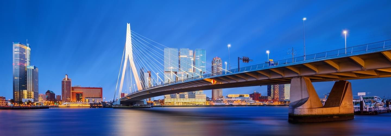 Night view of the Erasmusbrug bridge, The Swan, by Ben Van Berkel over the Nieuwe Maas in Rotterdam.